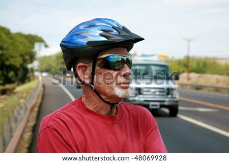 an active retired senior citizen enjoys outdoor activities like bike riding - stock photo