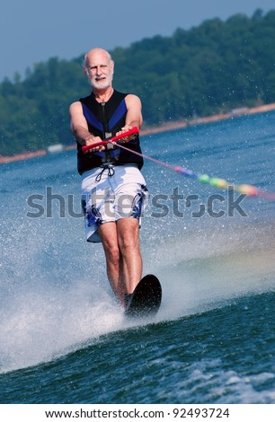 An active senior demonstrates his fitness and prowess on his water-ski.