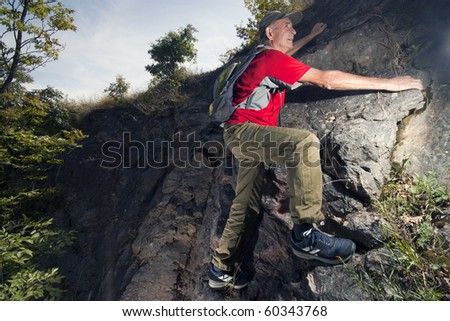 An Active Senior Hiking - stock photo