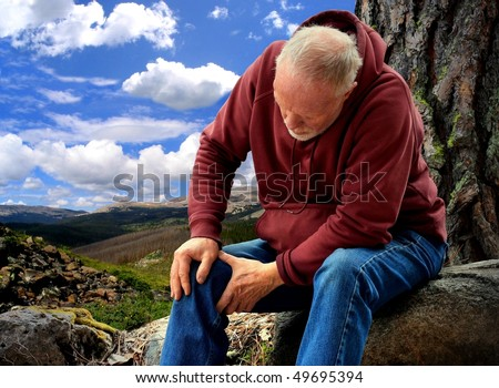 An Active Senior with Joint Pain - stock photo