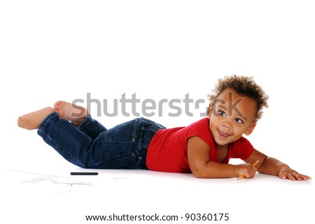 An adorable baby boy using a pencil and crayon to draw on the floor around him.  On a white background. - stock photo
