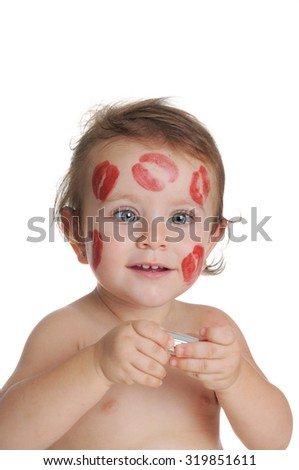 An adorable baby, full of traces of kisses on his face - stock photo