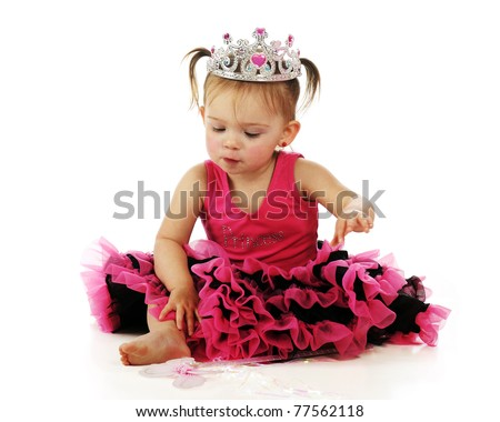 An adorable baby girl sitting pretty in her pink and black princess costume.  Isolated on white. - stock photo
