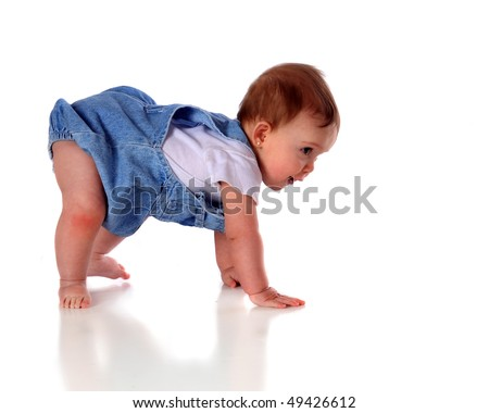 "An adorable baby girl ""walking"" on hands and feet.  Isolated on white. - stock photo"