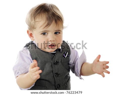 An adorable, dressed up baby boy giving applause.  Motion blur on hands.  Isolated on white. - stock photo