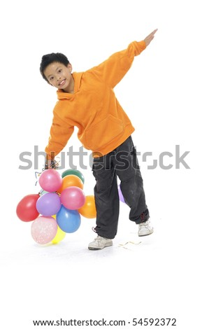 An Adorable Kid playing with coloured baloons isolated - stock photo