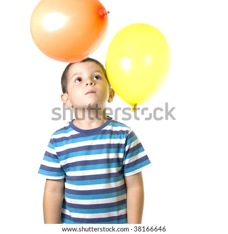 An Adorable Kid playing with coloured baloons isolated on white - stock photo