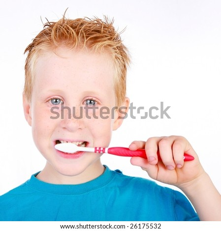 an adorable little boy brushing his teeth