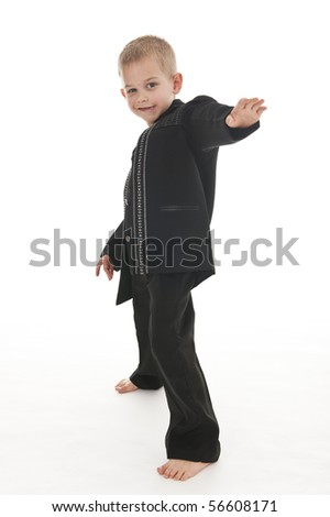 An adorable little boy in the studio wearing a rockstar outfit and pretending to do a performance.