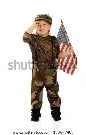 An adorable little girl in military camouflage happily saluting with an American flag in her left hand.  Isolated. - stock photo
