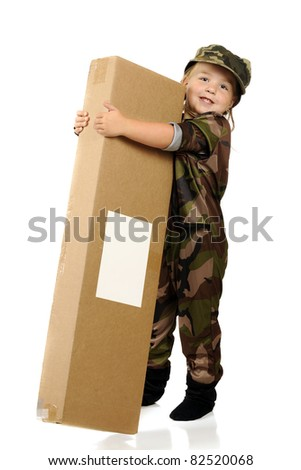 "An adorable little girl ""soldier"" happily receiving a gift from home.  Isolated on white. - stock photo"