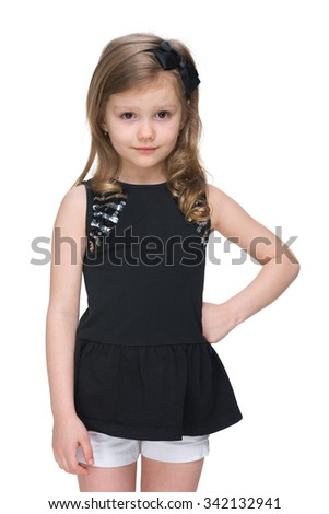 An adorable little girl stands on the white background