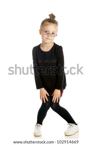 An adorable little girl with a tight bun and glasses down her nose goofing off with knock-kneed, pigeon toed stance.  On a white background. - stock photo