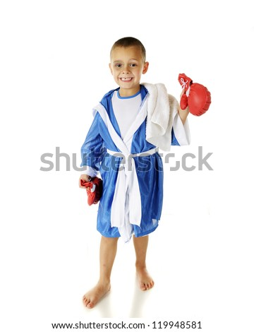 """An adorable preschool """"boxer"""" with his robe on and his gloves off after the fight.  He's happy in spite of a black eye and missing tooth.  On a white background. - stock photo"""