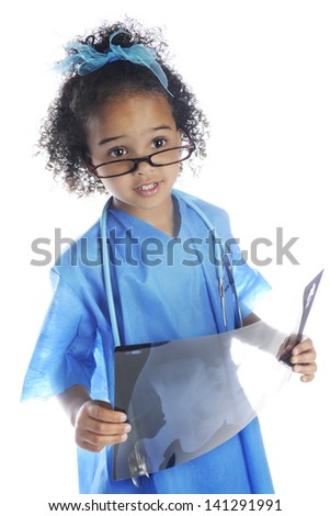 """An adorable preschool """"doctor"""" peering over her glasses as she examines the x-ray she's holding.  On a white background. - stock photo"""