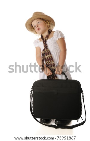 An adorable preschool girl looking after her grandfather while carrying a computer case and wearing a sundress, a man's old fashioned hat and a tie.  Isolated on white. - stock photo