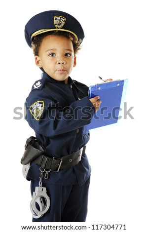 An adorable preschool policeman in uniform, looking up from writing a ticket.  On a white background.