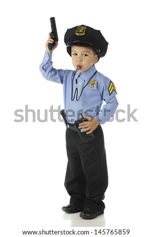 "An adorable preschool ""policeman"" ready for action with his gun raised in his right hand, his whistle in his mouth and his left hand on his walkie-talkie.  On a white background."