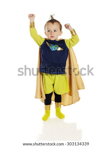 An adorable preschool superhero with a heart-shaped world on his chest, raising his fists -- one higher than the other.  On a white background. - stock photo