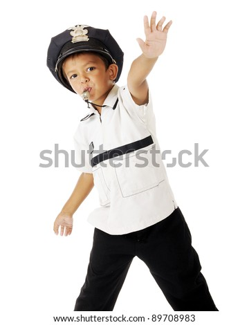 "An adorable preschooler playing policeman.  He's blowing on his whistle and thrusting his hand out to signal ""stop!""  On a white background"