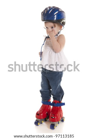 An adorable preschooler standing stone still in her helmet and plastic roller blades.  On a white background. - stock photo