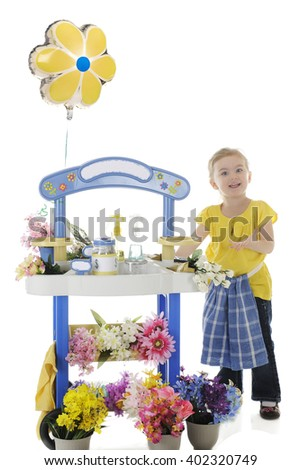 An adorable preschooler welcoming people to her flower stand.  Signs left blank for your text.  On a white background. - stock photo