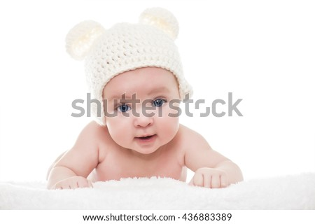 An adorable, smiling baby under a white blanket - stock photo