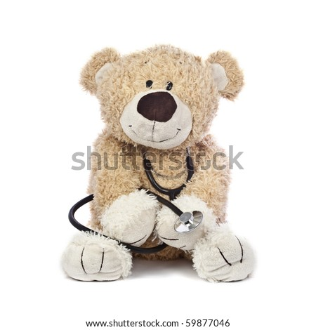 An adorable teddy bear, isolated on white, holding a stethoscope. - stock photo