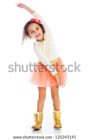 An adorable young African American girl with a bright smile - stock photo