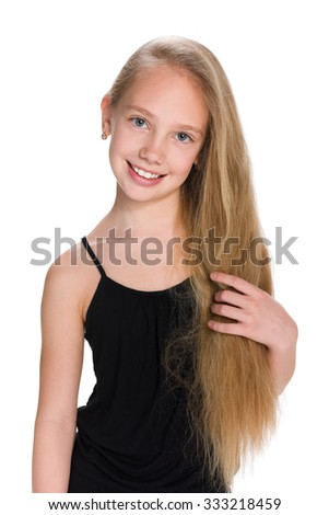 An adorable young girl stands against the white background - stock photo