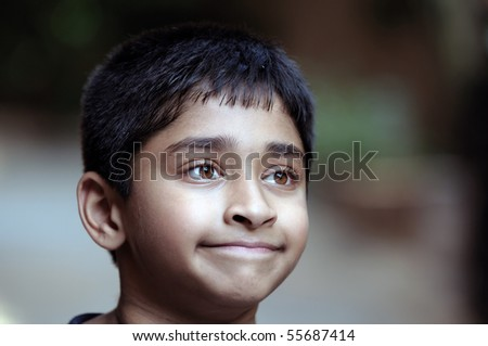 An adorable young Indian boy day dreaming - stock photo