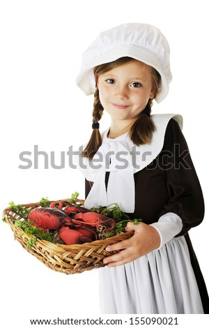 An adorable young Pilgrim girl carrying a basket of lobster (a likely offering at the first Thanksgiving).  On a white background. - stock photo