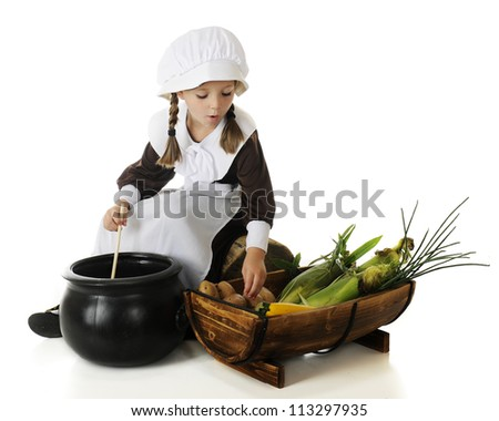 An adorable young pilgrim girl preparing vegetables for the first Thanksgiving.  On a white background. - stock photo