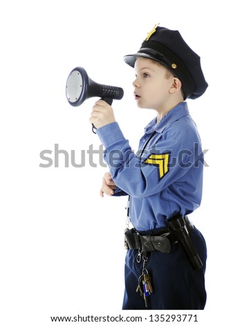"An adorable young ""policeman"" calling through a megaphone.  Isolated on white."