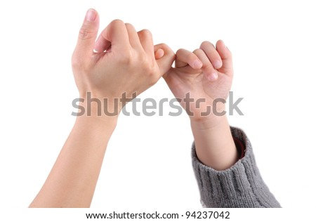 An adult and a child are making a promise sign, with hand in hand - stock photo