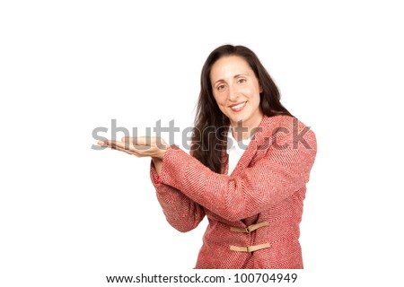 An adult businesswoman wearing a suite on a isolated white background holding a product with upturned hands - stock photo