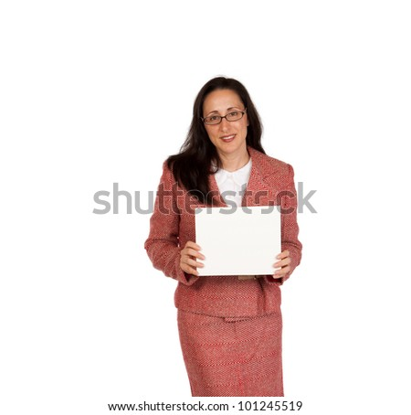 An adult businesswoman wearing a suite on a isolated white background holding a white board with room for copy