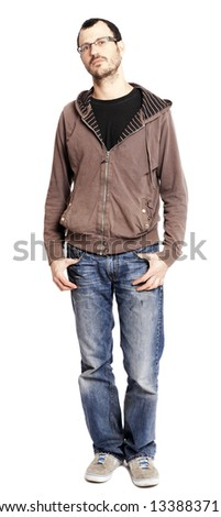 An adult caucasian man at his early 30's looking at the camera with an expression full of quiet confidence, a hint of a grin in his eyes. Isolated on white background. - stock photo