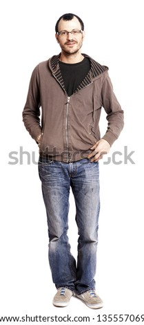 An adult Caucasian man in his early 30's looking at the camera with a cheerful expression which gives him the appearance of, well, not the sharpest knife in the drawer. Isolated on white background.
