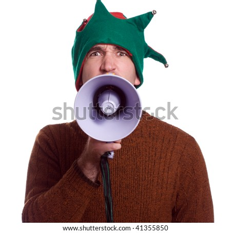 An adult Christmas elf is using a megaphone to yell at the viewer and is isolated against a white background - stock photo