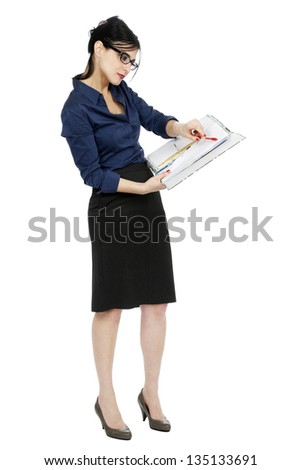An adult (early 30's) Caucasian woman holding a ring binder folder and pointing with her pen to a certain detail in the document. Isolated on white background. - stock photo