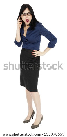 An adult (early 30's) Caucasian woman, wearing a blue buttoned shirt and a dark gray skirt, and her awed expression suggests she is completely in shock. Isolated on white background. - stock photo