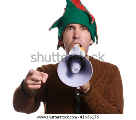 An adult elf is hollering into a megaphone and pointing with his finger - stock photo