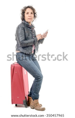 an adult woman is traveling. Woman with a suitcase