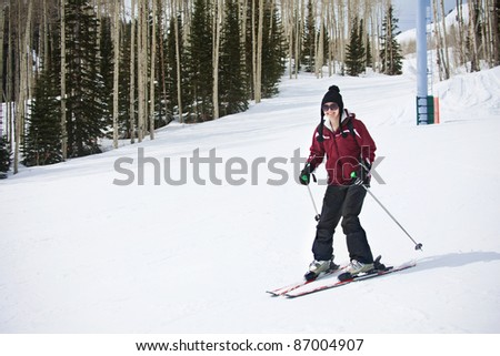 An Adult woman learning to Ski - stock photo