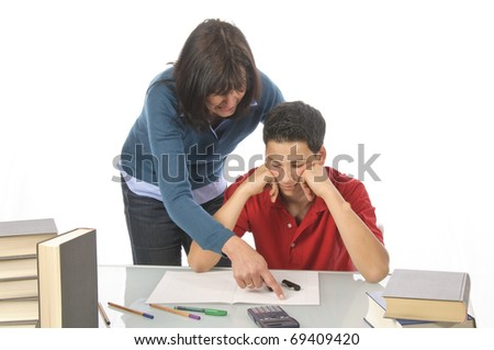 An adult woman, mother helps her son at the desk to make the homework, make the test, isolated against a white background. - stock photo