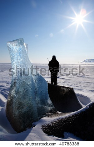 An adventure guide looks onto the horizon on the east coast of Spitsbergen, Svalbard, Norway