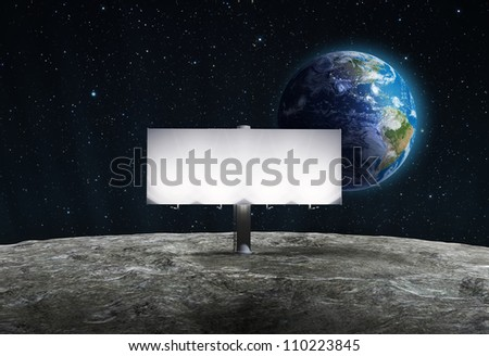 An advertising billboard placed on the  surface of View of the Moon with the rising Earth in the background - stock photo