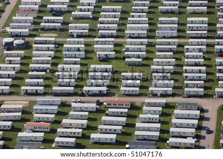 An aerial image of a caravan holiday park. - stock photo