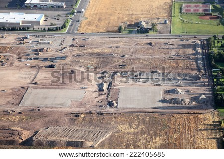An aerial image of a commercial real estate development under construction - stock photo
